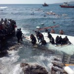 Ship with large number of undocumented migrants runs aground at Rhodes